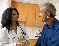 head and neck cancer doctor with patient